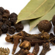 Bay leafs, cloves and black pepper - Stock Photo