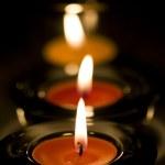 Three candles flaming — Stock Photo #1278257