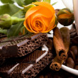 Chocolate, coffee, cinnamon and flower — Stock Photo