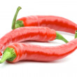 Three red chilly peppers — Stock Photo