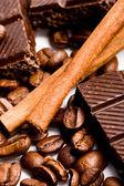 Chocolate, coffee and cinnamon sticks — Stock Photo