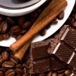 Cup of coffee, beans, cinnamon — Stock Photo