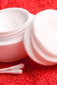 Cotton pads and facial creme — Stock Photo