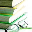 Stack of books and glasses — Stock Photo