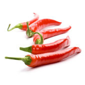 Five red chilly peppers — Stock Photo
