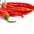 Five red chilli peppers — Stock Photo