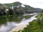 Monastery at the river — Stock Photo