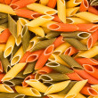 Multi-coloured macaroni, a background - Stock Photo