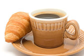 Black coffee with a croissant — Stock Photo
