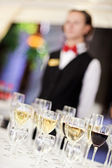 Set of wine glasses with waiter on blurr — Stock Photo
