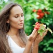 Beautiful girl with guelder rose — Stock Photo