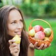 Stock Photo: Beautiful girl outdoor with apples