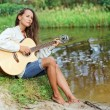 Beautiful young woman with guitar — Foto de Stock