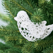 White sewing bird Christmas decoration - Stock Photo