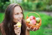 Beautiful girl outdoor with apples — Stock Photo