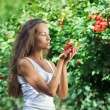 Beautiful woman with guelder rose — Stock Photo