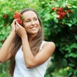 Beautiful woman with guelder rose - Stock Photo