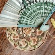 Bali fan on the table in orient style - Stock Photo