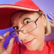 Funny surprised woman portrait on vivid - Stock Photo