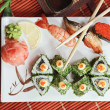 Royalty-Free Stock Photo: Bamboo rolls and sushi with a shrimp