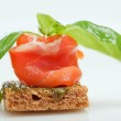 Salmon canape with basil on white — Stock Photo