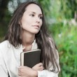 Thoughtful Young lady with book — Stock Photo