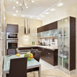 Modern Kitchen interior in warm tones — Stock Photo #1054406