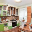 Green Kitchen interior with many utensil - Stock Photo
