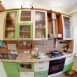Green Kitchen interior with many utensil — Stok fotoğraf