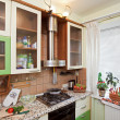Part of Green Kitchen interior with many — Stock Photo