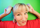 Funny cunning woman portrait on vivid — Stock Photo
