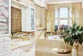 Gold bathroom interior in romantic style — Stock Photo