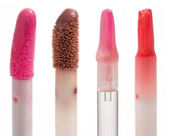 Four color gloss lipstick Brushes — Stock Photo