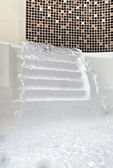 Falling water jet in Jacuzzi — Stock Photo