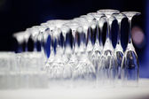 Upturned set of wine glasses on blurred — Stock Photo