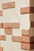 Brickwork Wall striped by sunlight — Stock Photo