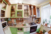Green Kitchen interior with many utensil — Stock Photo