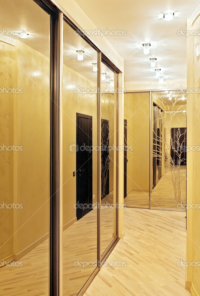 Passage with a mirror wardrobe in warm tones  Stock Photo #1055407