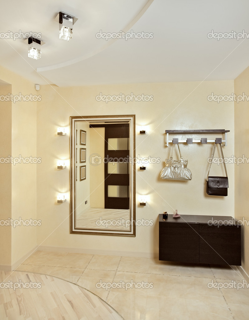Hall in beige tones with hallstand and golden mirror — Stock Photo #1055957