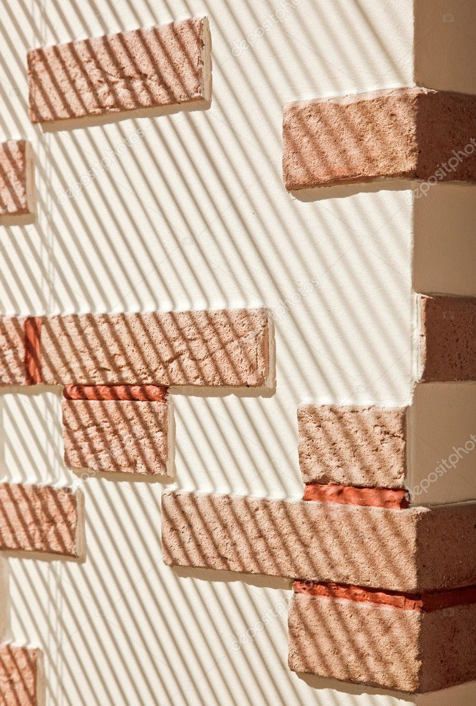 Brickwork Wall striped by sunlight — Stock Photo #1057893