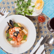 Seafood soup with shrimps and mussels - Stock Photo