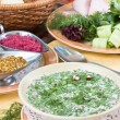 Summer kvass soup (okroshka) on served t — Stock Photo