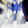 Upturned set of wine glasses on blurred - Stock Photo