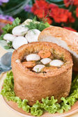 Mushroom soup in bread bowl — Stock Photo