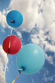 Three vivid color balloons on blue sky — Stock Photo