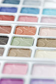 Multicolored eyeshadow palette on white — Stock Photo