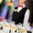 Set of wine glasses with waiter — Stock Photo