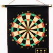 Darts set on a black sheet board - Stock Photo