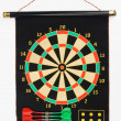 Darts set on a black sheet board — Stock Photo
