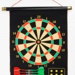 Darts set on a black sheet board — Stock Photo